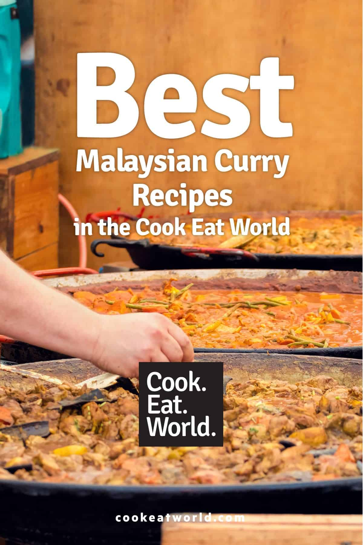 A man picks from a variety of Malaysian street food curries