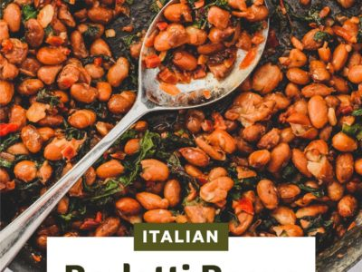 Borlotti beans cooked with chard (silverbeet) on a plate with a fork