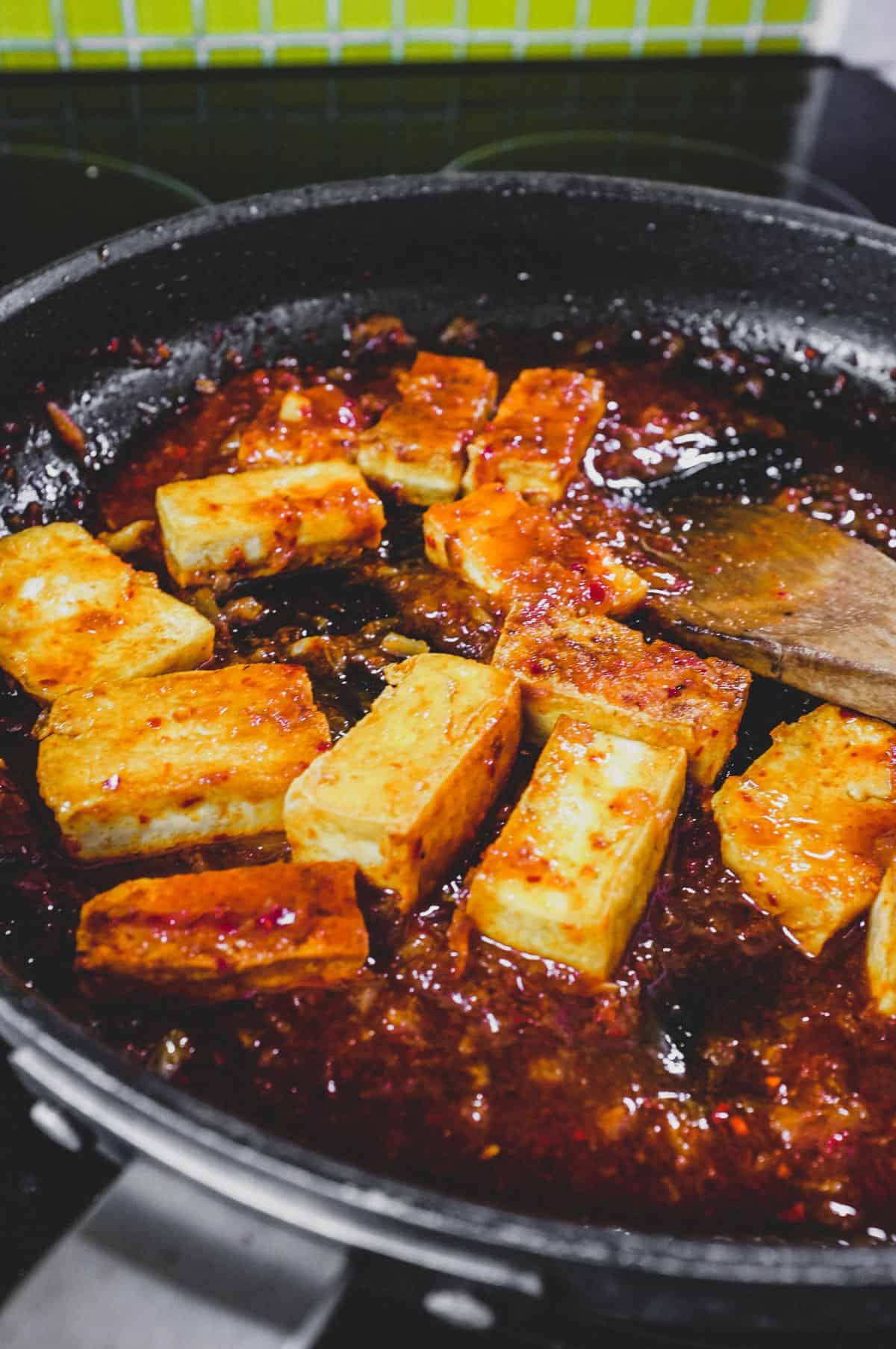 Fried tofu is lightly braised in Korean chilli (gochugaru)