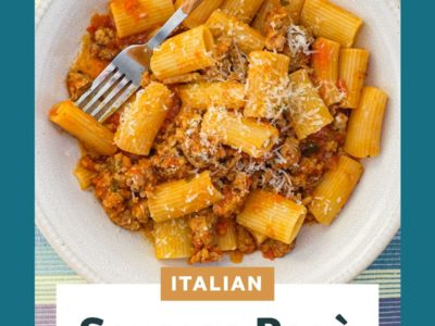 Rigatoni pasta in a bowl with sausage cooked in tomato sauce
