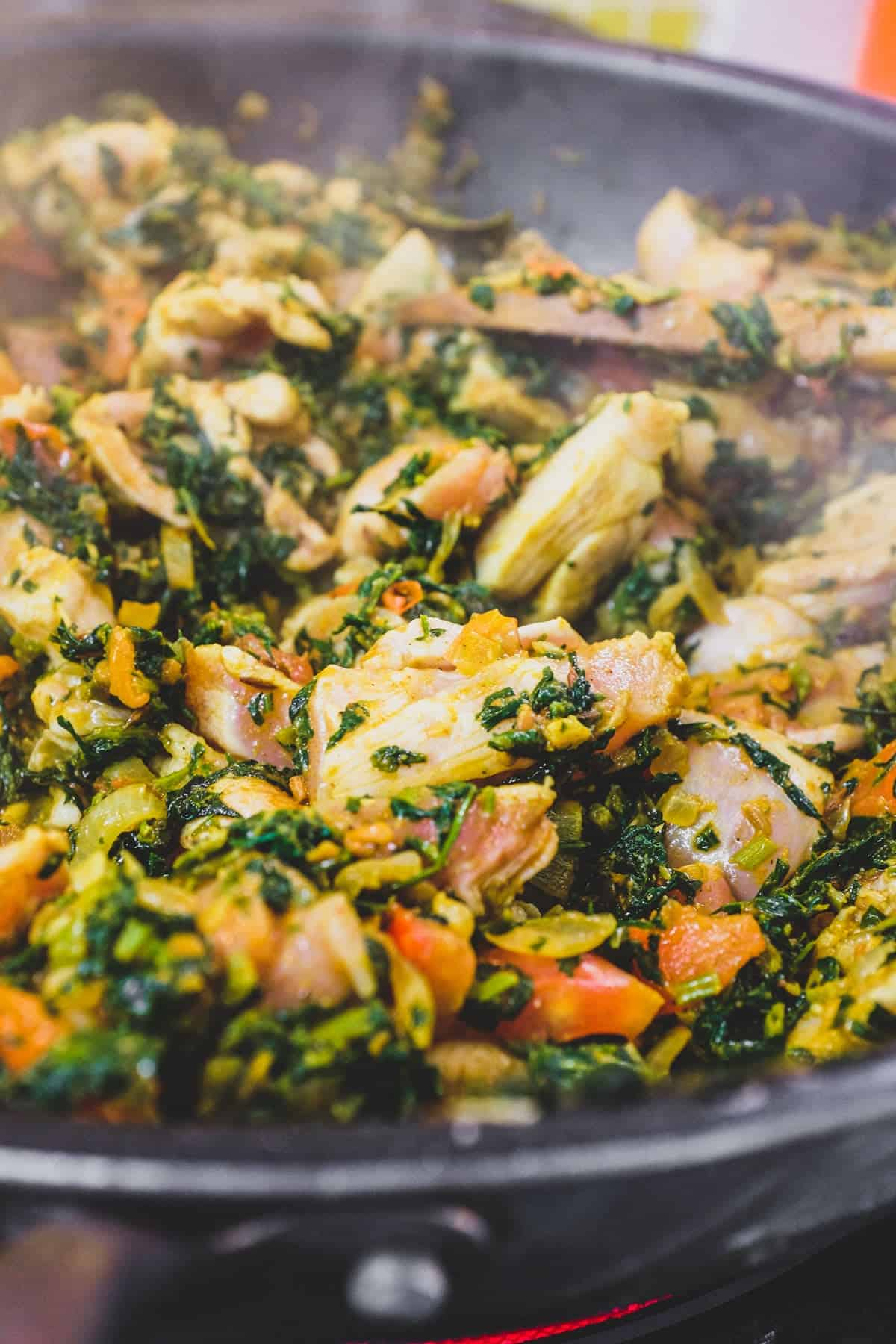 A pan with chicken curry made with fenugreek leaves
