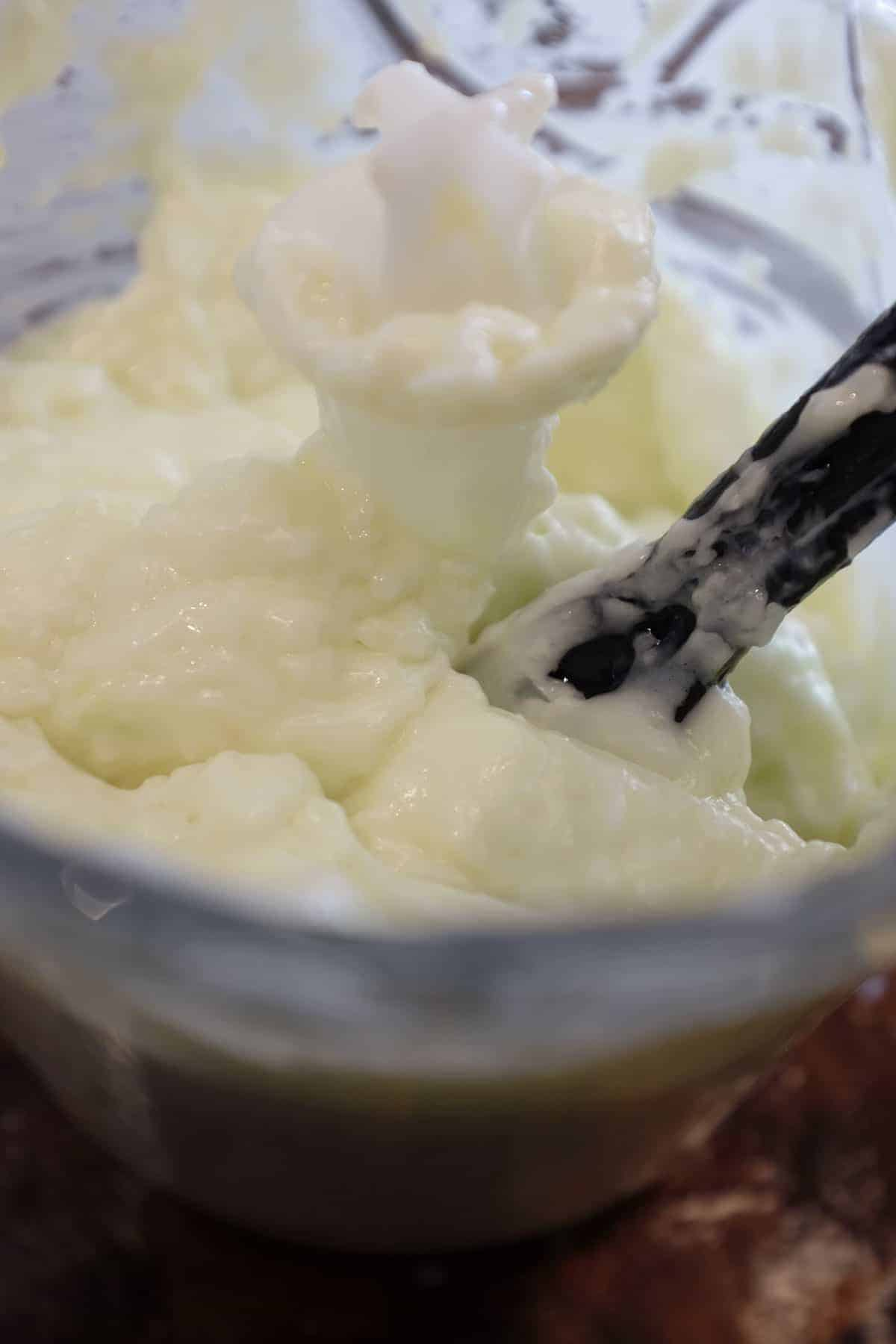 Garlic and oil is whipped in the food processor into a thick, creamy sauce called toum.